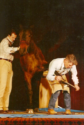 Burney Chapman works on a horse on stage at the AFA convention