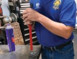 Farrier Justin Fry places grip on tool handle