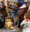 Group of farrier students participate in a product demonstration.